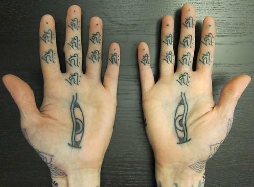 Palm Tattoos by Thomas Hooper