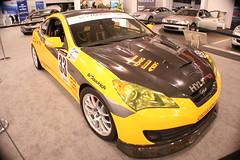 automobile(1.0), automotive exterior(1.0), wheel(1.0), vehicle(1.0), automotive design(1.0), auto show(1.0), mid-size car(1.0), hyundai genesis coupe(1.0), bumper(1.0), sedan(1.0), land vehicle(1.0), coupã©(1.0), supercar(1.0), sports car(1.0),