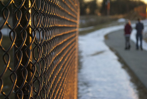 sunset snow metal fence walk chainlink goldenhour