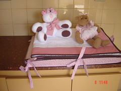 furniture(0.0), bed sheet(0.0), bed(0.0), baby products(0.0), art(1.0), textile(1.0), room(1.0), stuffed toy(1.0), pink(1.0), toy(1.0),