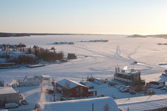 Ice roads connecting houseboats on a frozen Great Slave Lake in Yellowknife