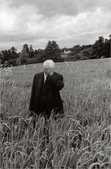 Robert Frost Standing in Oxford Field with His Hand Over His Face, by Howard Sochurek 1957