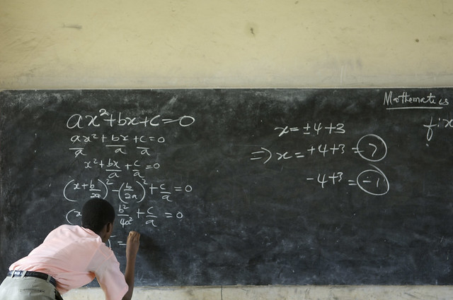 A student solves a mathematics equation at the Mfantsipim Boys School in Cape Coast