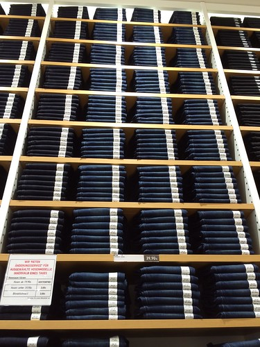 Berlin Uniqlo flagship store opening_jeans stacked in tall denim wall