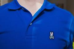 turquoise(0.0), jacket(0.0), pocket(0.0), brand(0.0), clothing(1.0), collar(1.0), sleeve(1.0), cobalt blue(1.0), outerwear(1.0), polo shirt(1.0), azure(1.0), electric blue(1.0), blue(1.0), t-shirt(1.0),