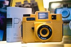 digital slr(0.0), cameras & optics(1.0), digital camera(1.0), camera(1.0), yellow(1.0), single lens reflex camera(1.0), reflex camera(1.0),
