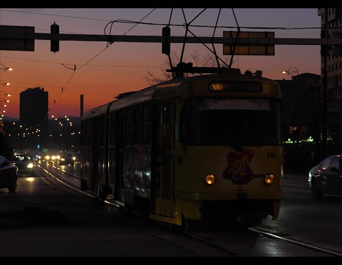 road sunset orange sun bus cars car sunrise lights purple sarajevo bosnia centre tracks tram headlights balkans trolly passangers novosarajevo sarajev bosniaandherzegovinalandscape