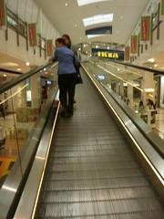 supermarket(0.0), transport(0.0), public transport(0.0), airport terminal(0.0), metro station(0.0), rapid transit(0.0), building(1.0), escalator(1.0),