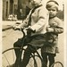 Two boys on a tricycle (c.1910) by pellethepoet