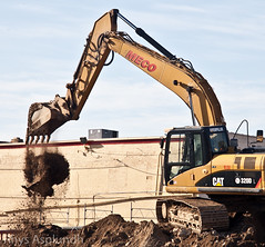 asphalt(0.0), crane(0.0), bulldozer(0.0), construction(0.0), vehicle(1.0), transport(1.0), demolition(1.0), construction equipment(1.0),