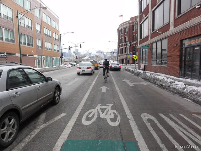 Which of these cars on the left will merge towards the left and block bicyclists?