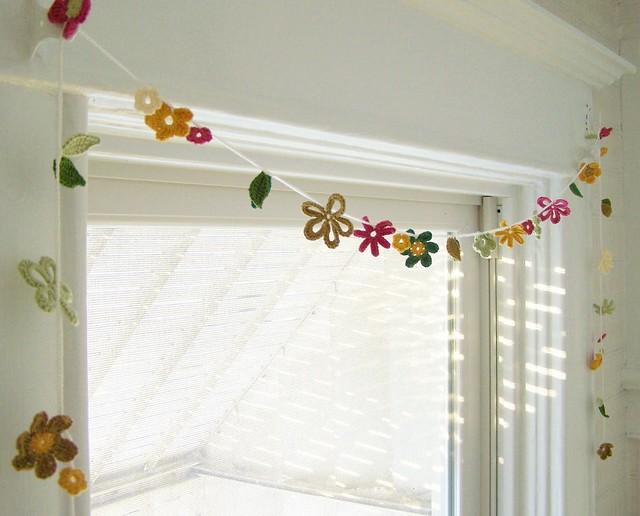 Hand crochet blossom garland by Emma Lamb