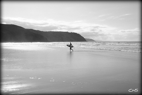 Surfing alone, Perranporth Beach, Cornwall by Stocker Images