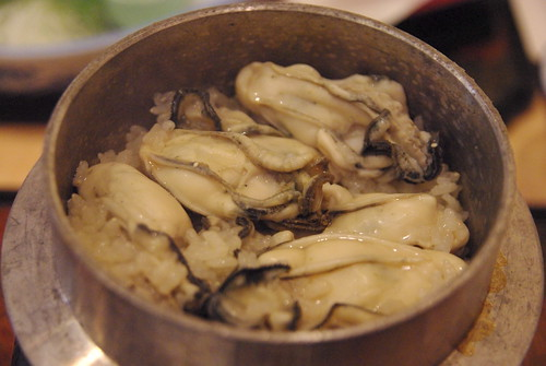 Oyster rice in a pot