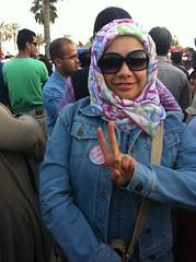 Journalist Nada Alwadi wearing Just Bahraini and protesting