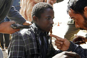 Counter-revolutionary U.S.-backed rebel forces in Libya threaten youth who supports the government of Muammar Gaddafi. Reports of detention and murder against patriots have been widespread since the war in 2011. by Pan-African News Wire File Photos