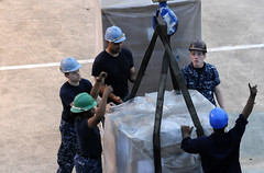 SINGAPORE (March 11, 2011) Sailors of U.S. 7th Fleet command flagship USS Blue Ridge (LCC 19) onload humanitarian assistance supplies in Singapore to ensure the ship and crew are ready to support earthquake and tsunami relief operations in Japan if directed. (U.S. Navy photo by Mass Communication Specialist 1st Josh Huebner)