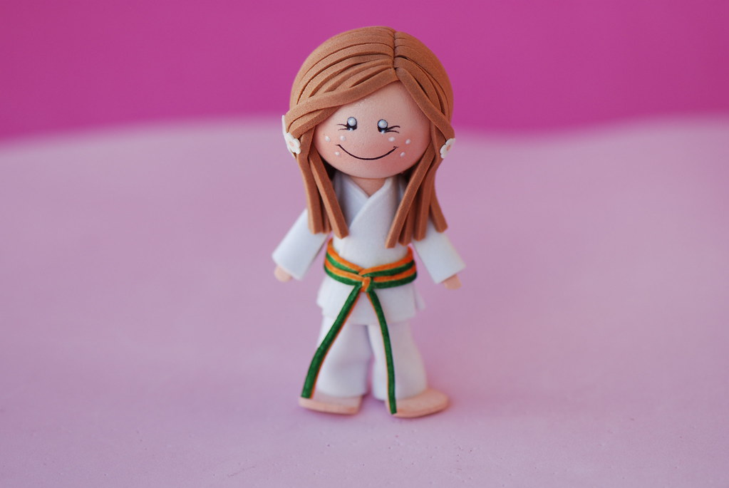 Karateka cinturón naranja/verde