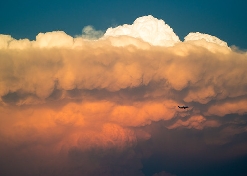 United Airplane by Dramatic Clouds