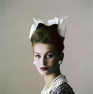 Model Anna Karin-Bjorck is wearing a little hat of black velvet and starched white organdie bows by Adolfo for Emme,  photo by Jerry Schatzberg for Vogue Feb. 1960
