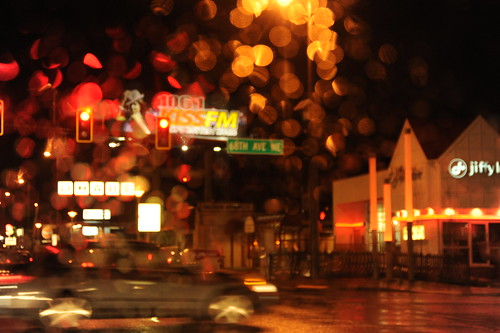 Everything is wet, Aurora Avenue in the rain, traffic lights, signs, car, Jiffy, 66th Ave, KISSFM, Seattle, Washington, USA