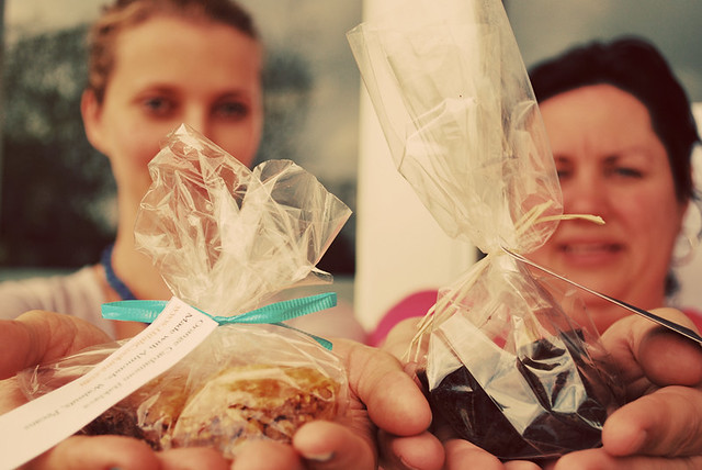 Hilah and Rochelle Holding Treats for The Austin Bakes for Japan Sale