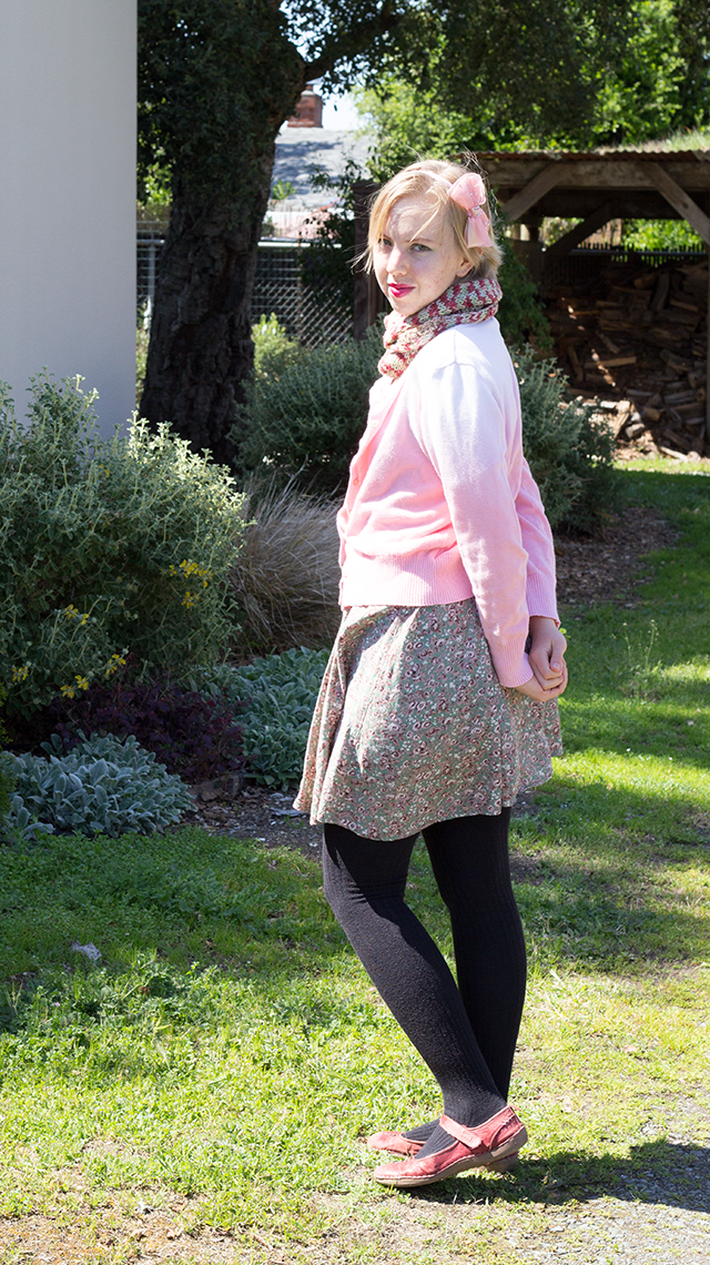 pink ombre cardigan, green floral dress, black stockings