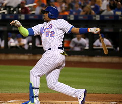 Mets outfielder Yoenis Cespedes swings at a pitch in the first inning.