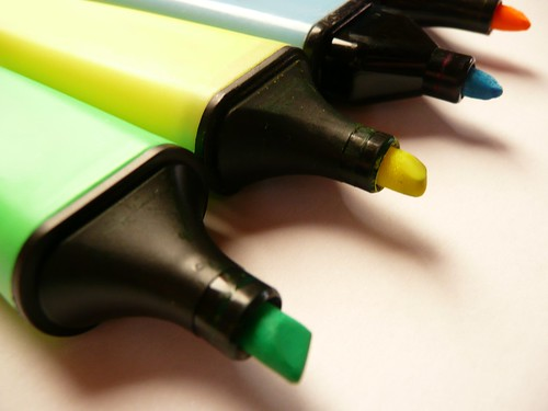 Close up / Macro of four felt-tip-pencils in green, yellow, blue and orange