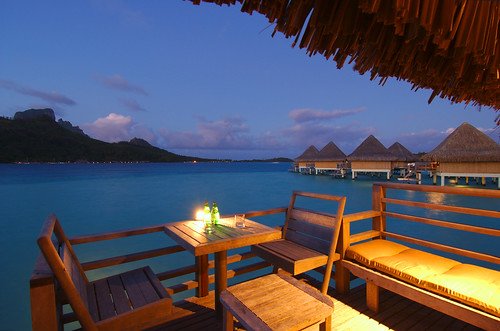 Sunset and lagoon view from the overwater bungalow's terrace at the InterContinental Bora Bora Le Moana...