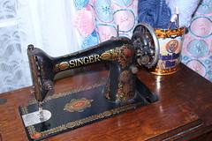 antique(0.0), sewing machine(1.0), art(1.0), iron(1.0),