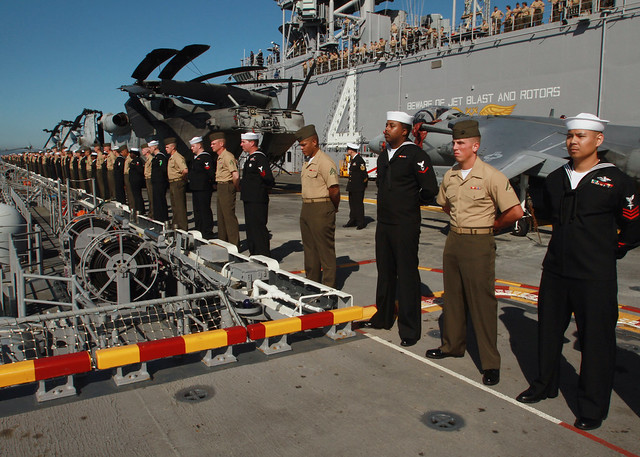 sailors and marines aboard uss boxer man the rails