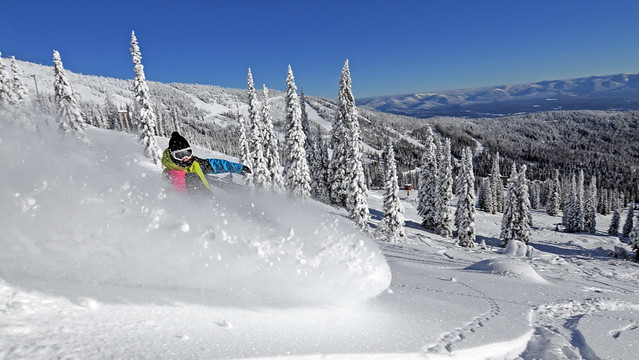 Skier rips through powder at Schweitzer Mountain