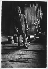 Gedney's Grandfather in barn, wearing hat, by William Gedney 1958