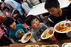 SHICHINOHE, Japan (March 26, 2011) Children laugh as they wait in line for a home cooked meal at the Biko-en Children's Care House during a community service project hosted by Naval Air Facility Misawa (NAFM). Along with the meal volunteers from NAFM and Misawa Air base donated food, clothing and toys to the center. (U.S. Navy photo by Mass Communication Specialist 2nd Class Devon Dow/Released)