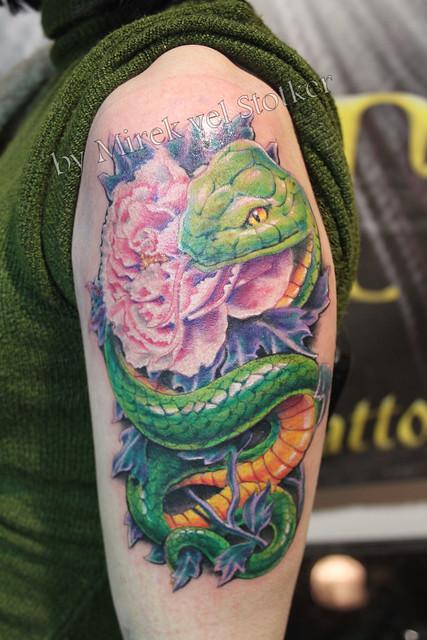 snake with peony tattoo by Mirek vel Stotker