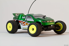 auto racing(0.0), racing(0.0), dirt track racing(0.0), off road racing(0.0), touring car(0.0), race car(1.0), model car(1.0), automobile(1.0), vehicle(1.0), open-wheel car(1.0), radio-controlled toy(1.0), motorsport(1.0), truggy(1.0), monster truck(1.0), toy(1.0),