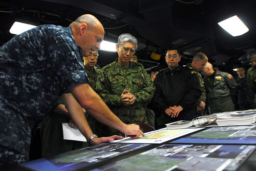Navy admiral briefs relief efforts to Japanese general.