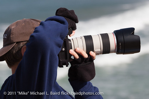 "Photographer Kevin Cole shooting a Canon 5D Mark II with the Canon 70-200mm f/2.8 glass at the WSA ""The Rock"" Surfing Contest, Morro Bay, CA 05 March 2011"