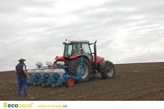 asphalt(0.0), crop(0.0), harvester(0.0), agriculture(1.0), farm(1.0), field(1.0), soil(1.0), vehicle(1.0), plough(1.0), agricultural machinery(1.0), tractor(1.0),