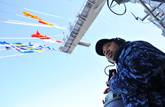 PACIFIC OCEAN (April 20, 2011) Quartermaster Seaman Shanelle Mitchell searches for navigation points while working as part of navigation detail aboard the aircraft carrier USS George Washington (CVN 73) as the ship makes its way back into its forward operating port of Fleet Activities Yokosuka, Japan. (U.S. Navy photo by Mass Communication Specialist 3rd Class Stephanie Smith)