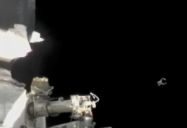 UFO flies near ISS as Russian astronaut space walks on CNN news cast, UFO Sighting news. May 2011.