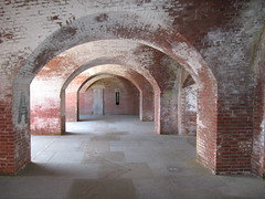 place of worship(0.0), hacienda(0.0), crypt(0.0), chapel(0.0), arch(1.0), building(1.0), wall(1.0), architecture(1.0), vault(1.0), arcade(1.0), brick(1.0), brickwork(1.0),