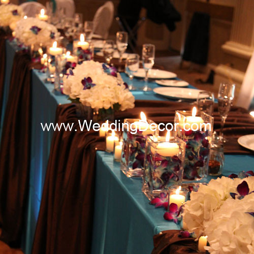 Head table decorations for a wedding reception in turquoise and brown with