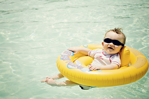 Chillin' out, maxin', relaxin', all cool, sitting in my floatie inside the pool...