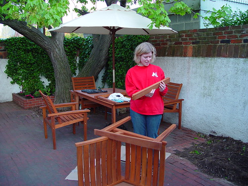 Wendy excitedly assembled the table in our backyard, carefully making sure  to use the right screws and parts. - Bringing Teak Outdoor Furniture Back From The Brink - Old Town Home