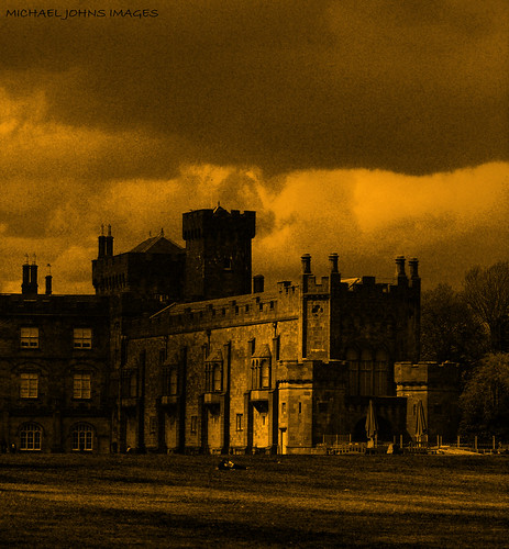 camera old ireland light shadow wild sky cloud storm black building tower castle art yellow wall clouds canon dark landscape gold flickr view bright photos entrance explore journey land grounds discover