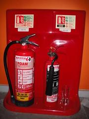 liqueur(0.0), bottle(0.0), drink(0.0), alcoholic beverage(0.0), red(1.0), distilled beverage(1.0), fire extinguisher(1.0),