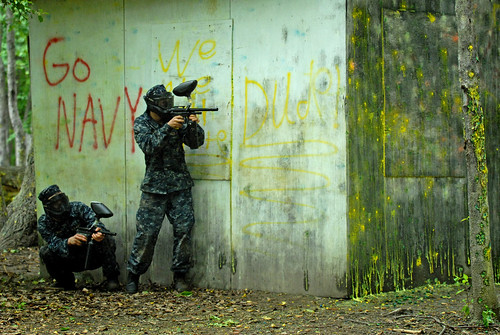 Plebes take cover during a paintball competition during Sea Trials, the capstone training exercise for freshmen