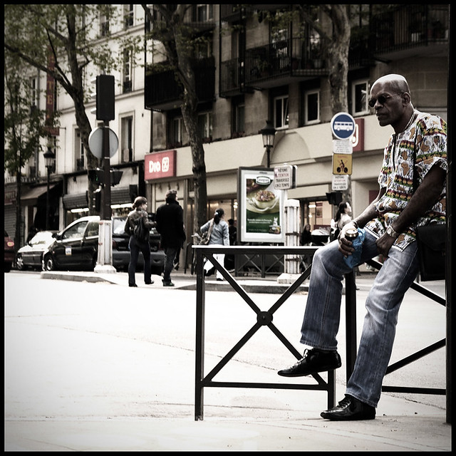 Portrait of seated man alone, Nikon D7000 Barbes Paris